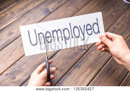 cuts white paper with word unemployed