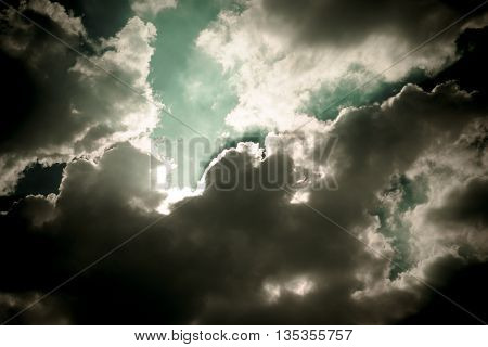Dark Sky With Sun Burst Ray With Cloudy