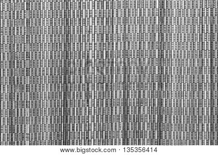 abstract vertical pattern of a cover from wooden straws of gray color for the textured background and for wallpaper
