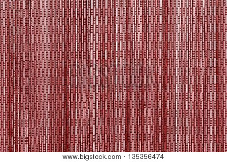 abstract vertical pattern of a cover from wooden straws of red color for the textured background and for wallpaper