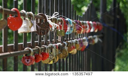 a padlock or other wedding which lovers hang locks as a sign of conclusion of the bonds