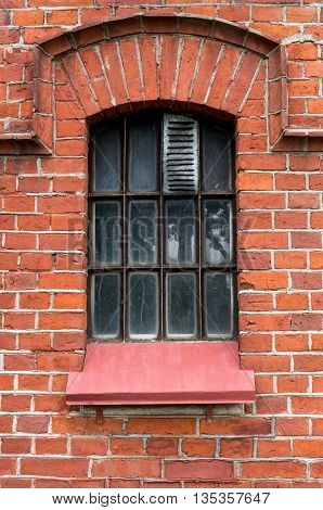 The old window in the red brick wall.