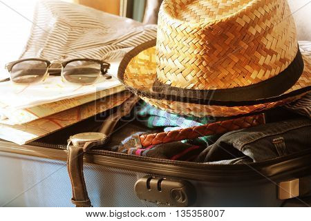 Travel Holiday accessories  in suitcase ( close up )