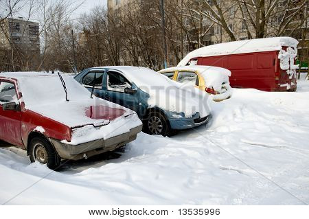 Parked Car Under Snow