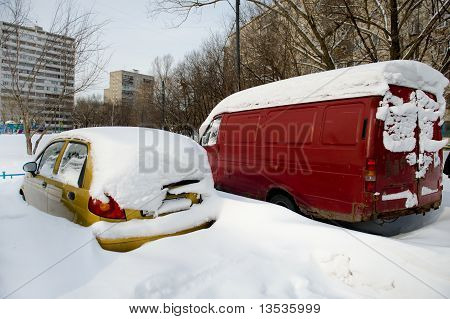 Parked Car Under Snow Close Up