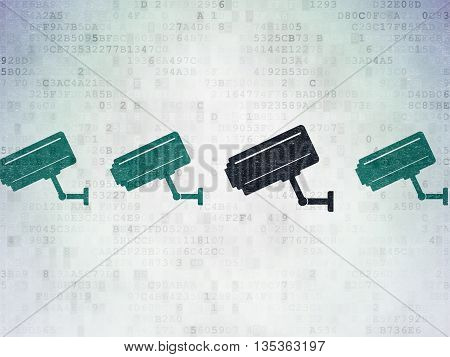 Safety concept: row of Painted blue cctv camera icons around black cctv camera icon on Digital Data Paper background