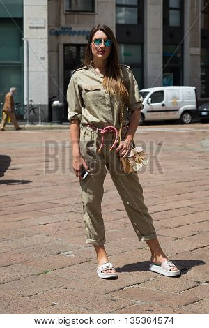 MILAN ITALY - JUNE 19: Fashionable woman poses outside Ferragamo fashion show building during Milan Men's Fashion Week on JUNE 19 2016 in Milan.