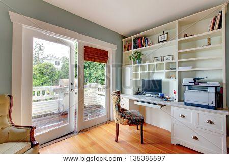 Home Office With White Open Shelves, Desk And Hardwood Floor.