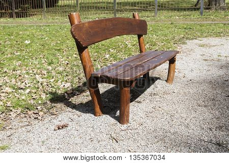 simple wooden garden bench in the park