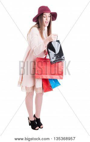 Full Body Of Curious Young Shopaholic Carrying Shopping Bags