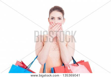 Woman Holding Shopping Bags Covering Her Mouth As Being Mute