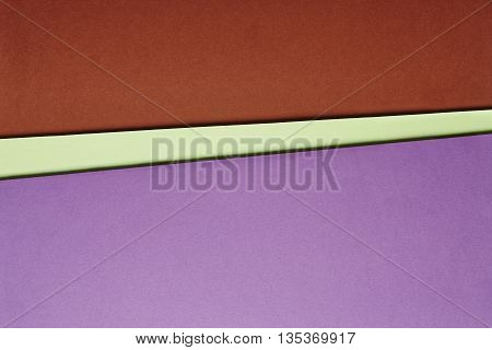 Colored cardboards background in purple green red tone. Copy space. Horizontal