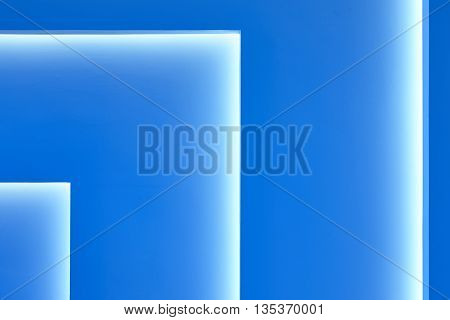 Blue wall with gradient light decoration in angle. Horizontal