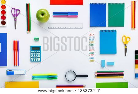 Frame with school supplies on a white background. Flat lay top view