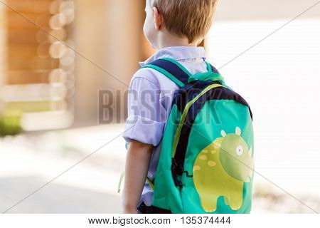 Child leaving home to his first day of kindergarten