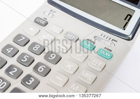 Tax calculator on green button with 7 number (7 percent) on display
