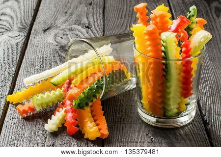 Colorful slices of raw vegetables in glasses (carrots celery cucumber sweet pepper). The concept of diet healthy and vegetarian food