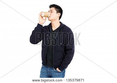 Young man having coffee on white background