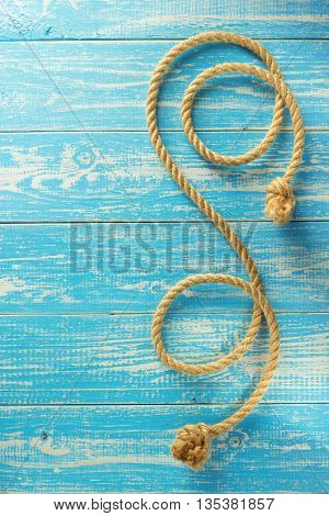 ship rope on wooden background