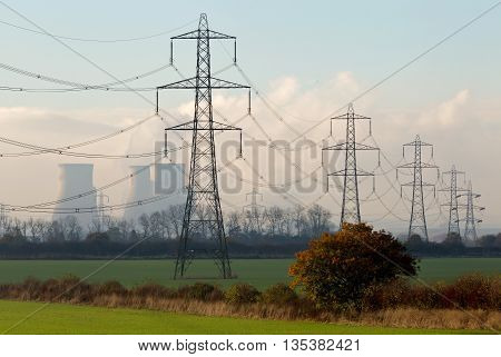 CULHAM, UK - NOVEMBER 18: A series of high voltage power lines lead back to the coal fired power station at Didcot on November 18, 2014 in Culham. The Didcot A power station was closed in March 2013