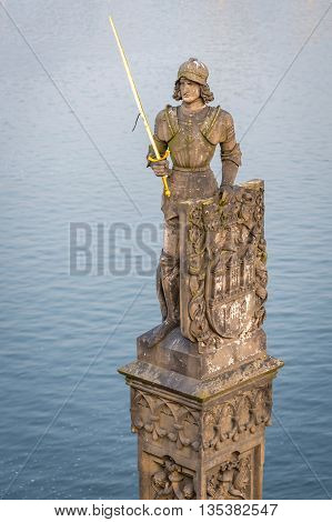 Prague Czech Republic - May 25 2016: View of statue of the knight Bruncvik at south side of Charles bridge. By legend knight will save Bohemia in the worst times.