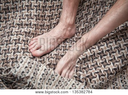 Man Feet On Woolen Plaid