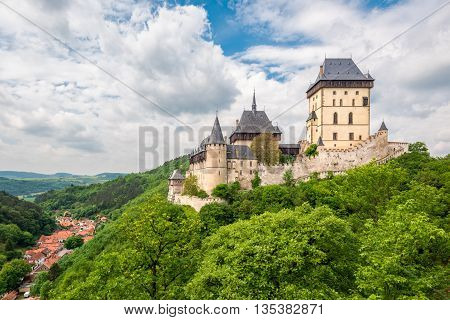 Karlstein Czech Republic - May 26 2016: Karlstein Castle is a large Gothic castle founded in 1348 by King Charles IV Holy Roman Emperor and King of Bohemia. The castle served as a place for safekeeping the Imperial Regalia Bohemian/Czech crown jewels holy