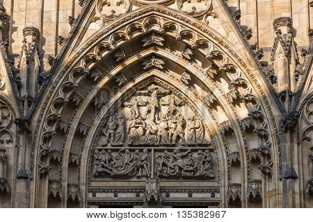 Prague Czech Republic - May 26 2016: Close up view of central tympanun with Passion scene at Metropolitan Cathedral of Saints Vitus Wenceslaus and Adalbert.