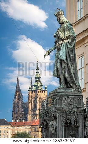 Prague Czech Republic - May 28 2016: King Charles IV monument at Crusaders' Square in Prague. St. Vitus cathedral at Prague castle in background.