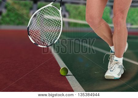 Composite image of athlete playing tennis in a stadium
