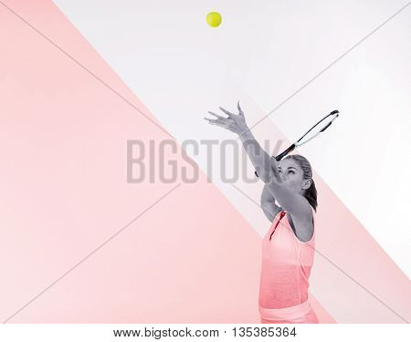 Athlete serving with her tennis racket on a multicoloured background