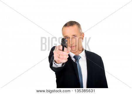 Serious mafia agent aiming by handgun