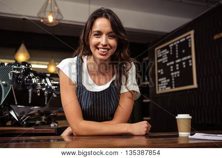 Portrait of smiling barista at coffee shop