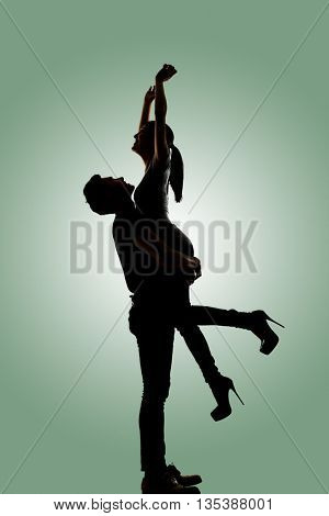 Silhouette of young Asian couple, full length portrait isolated.