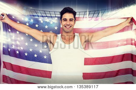 Athlete posing with american flag after victory against american football arena
