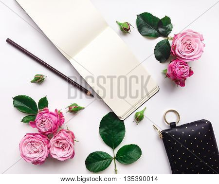 Colorful Composition With Sketchbook, Roses And Accessories. Flat Lay, Top View