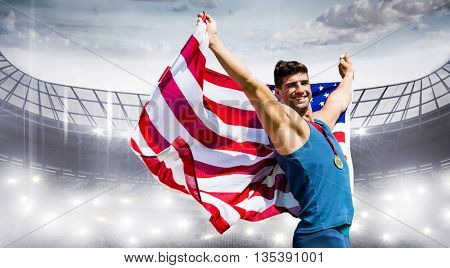 Sportsman celebrating his victory with American flag and medal in a stadium