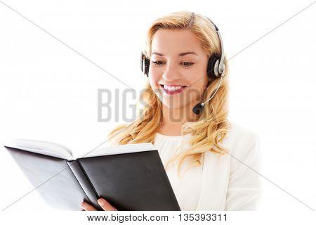 Closeup portrait of female customer service representative wearing headset.