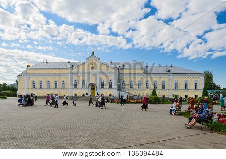 DIVEEVO RUSSIA - AUGUST 22 2015: Unidentified people are on Cathedral Square near Refectory Housing in Holy Trinity Seraphim-Diveevo monastery in village of Diveevo Russia