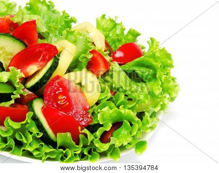Fresh vegetable salad isolated on a white background