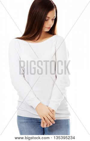Beautiful sad woman standing with crossed hands