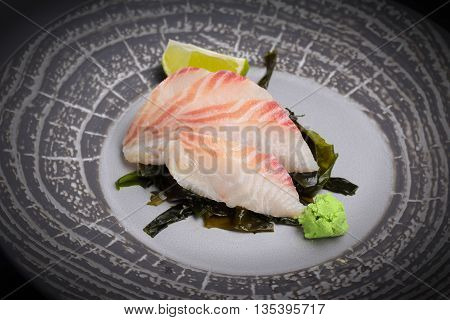 Japanese Cuisine. Sushi. Perch Sashimi On A Round Plate