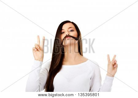 Funny student woman putting hair like moustache