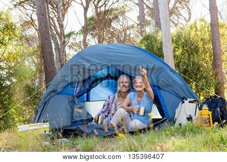 Mature couple looking up on camp site