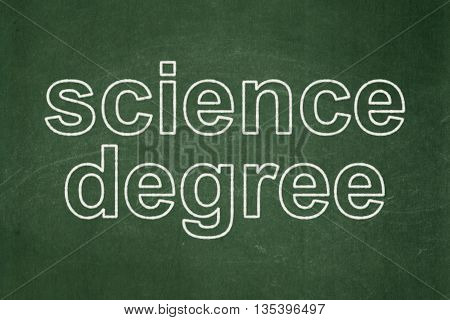 Science concept: text Science Degree on Green chalkboard background