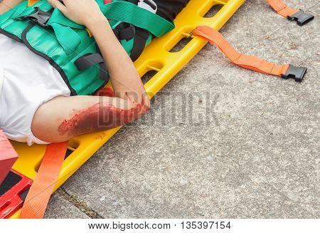 patient Injury upper arm, Wait physician on stretcher assist patient in emergency rescue, situations, stretcher for people with injuries, example of medical equipment using to transport patient. (select focus Wound to the arm) (accident victim)