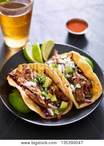 mexican street tacos with pork carnitas, red cabbage, cilantro and onion
