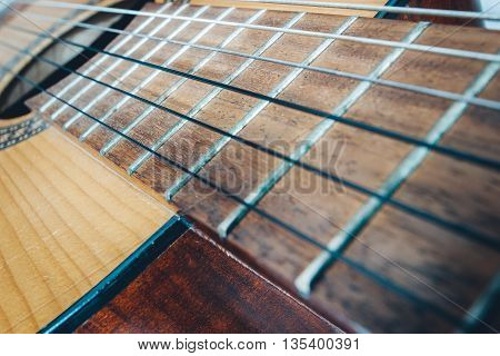 photography of an acoustic guitar close up
