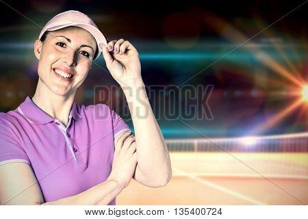 Sportswoman posing on black background against composite image of tennis net