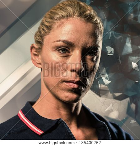 Close-up of female tennis player against angular design